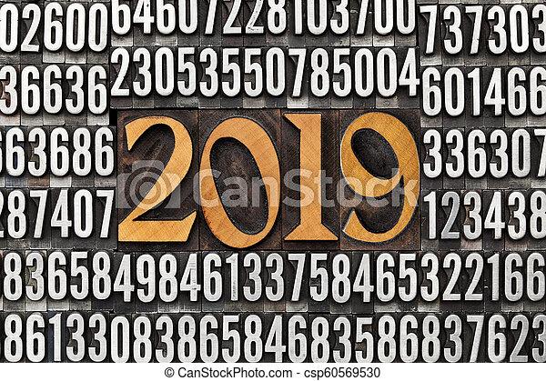 year 2019 in letterpress type - csp60569530