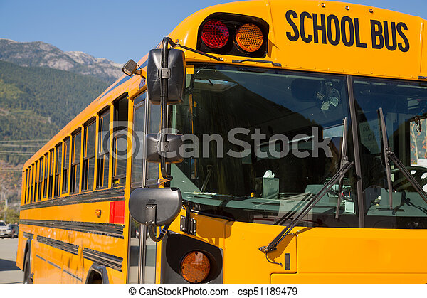 Yellow american schoolbus background closeup - csp51189479