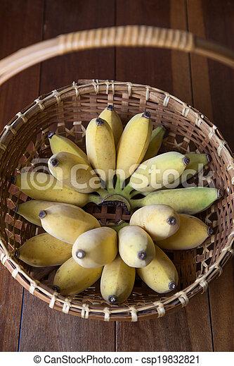 Yellow banana in basket - csp19832821