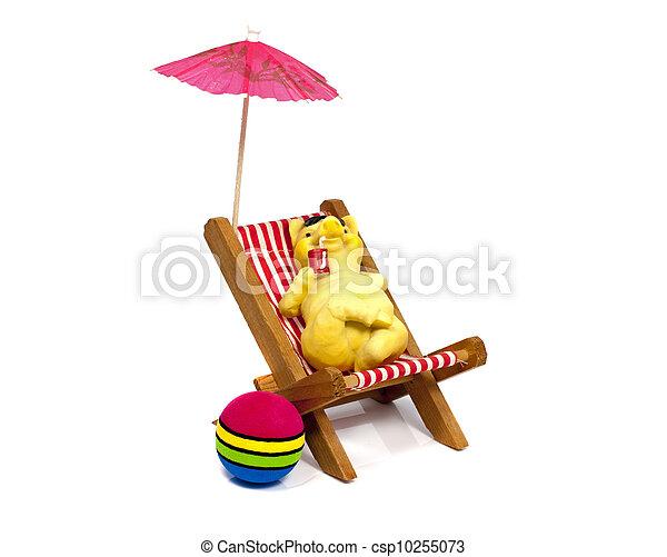 yellow bear in a beach chair drinking - csp10255073