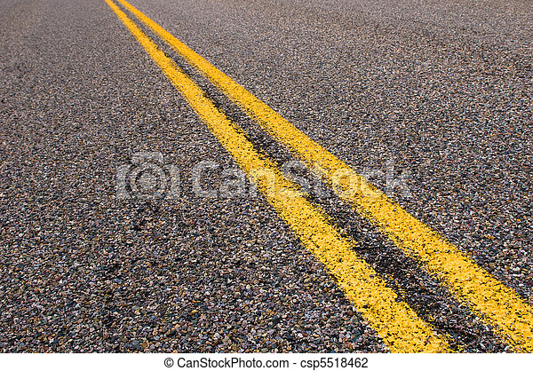 yellow dividing lines on the highway  - csp5518462