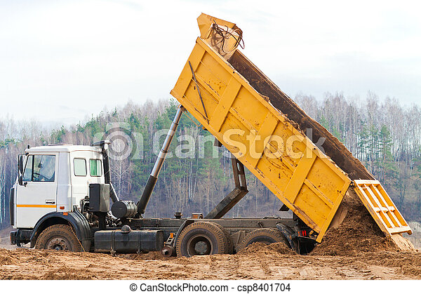 Yellow Dump Truck Unloading A Mountain Of Soil From The