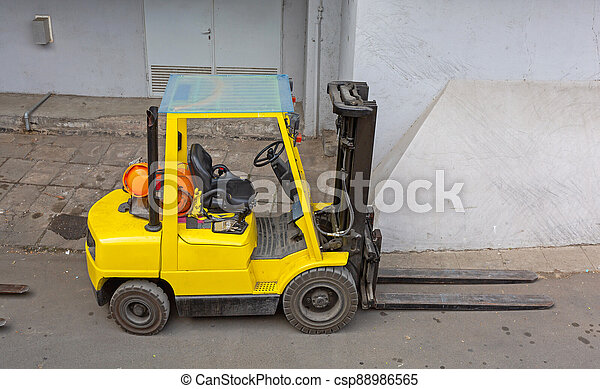 Yellow Forklift Outside - csp88986565