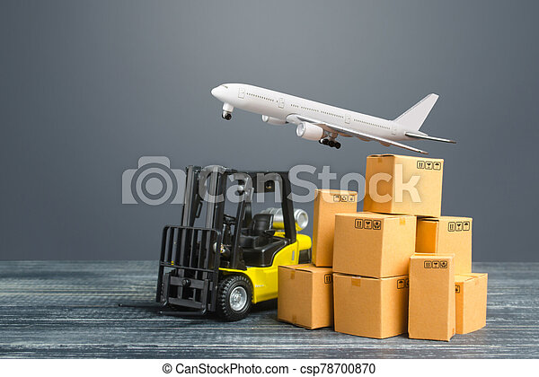 Yellow Forklift truck and cardboard boxes and freight plane. Production, transport, cargo storage. Freight shipping. retail. Transportation logistics infrastructure, import and export goods delivery. - csp78700870