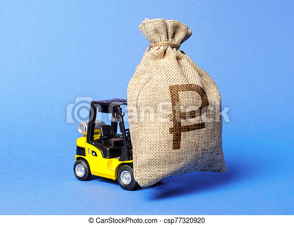 Yellow forklift truck carries a money bag of Russian ruble. Attracting investment in development, modernization of production and business. capital migration. Revenue, profit, liquidity. - csp77320920