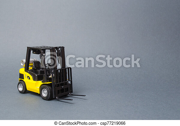 Yellow forklift truck on gray background. Warehouse equipment, vehicle. Logistics and transport infrastructure, industry and agriculture. Unloading, transportation, sorting, loading cargo. - csp77219066
