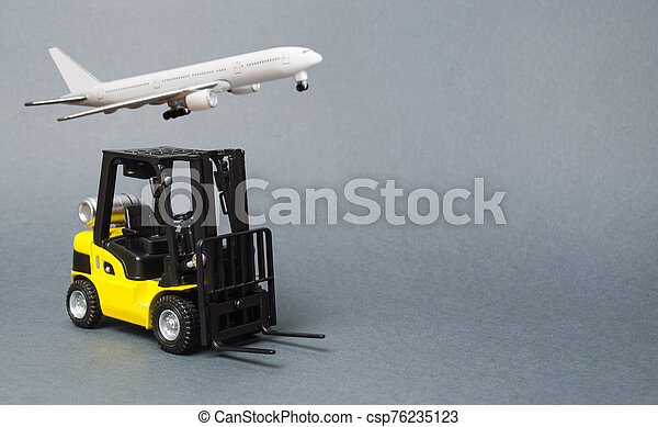 Yellow forklift truck on gray background. Warehouse equipment, vehicle. Logistics and transport infrastructure, industry and agriculture. Unloading, transportation, sorting, loading cargo. - csp76235123