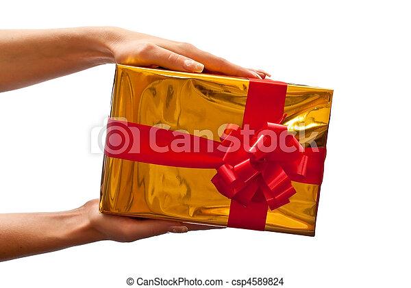 Yellow gift box in woman's hand - csp4589824