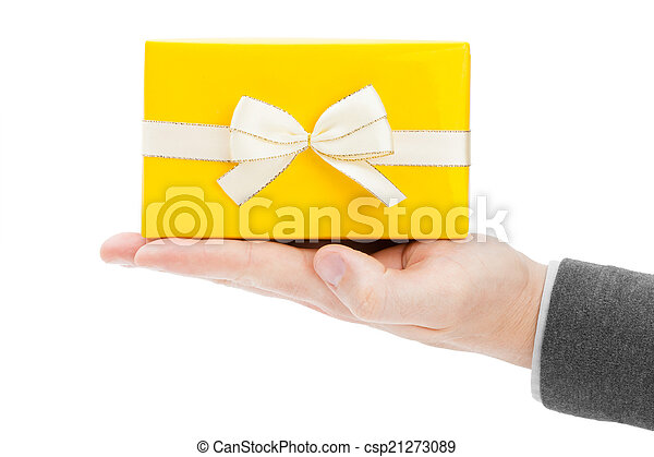 Yellow gift box with golden edge ribbon on male palm - csp21273089