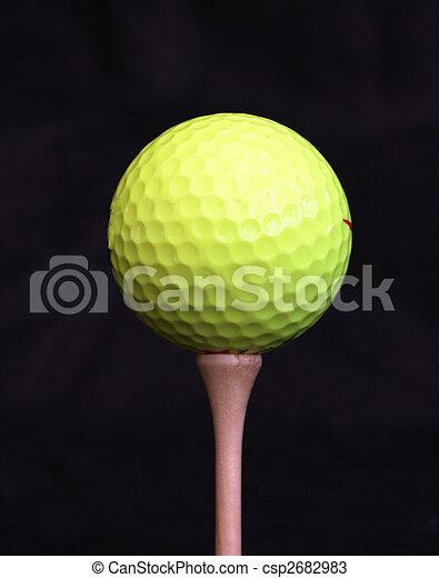 Yellow golf ball on a tee - csp2682983