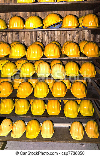 yellow helmets for visitors at the gem mine - csp7738350