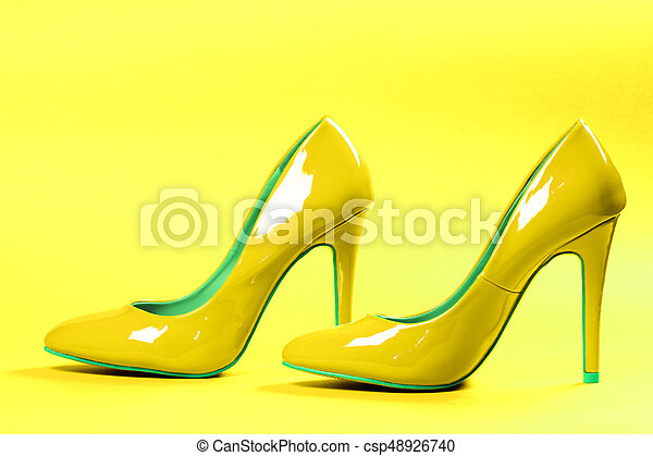 2959355b53fd Pair of Lime Green High Heel Shoes on White Background Stock Photo –  44632376. yellow high heels – csp48926740