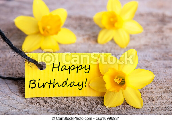 Yellow Label With Happy Birthday And Daffodil Blossoms In The