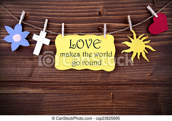 Yellow Label With Life Quote Love Makes The World Go round - csp23825695