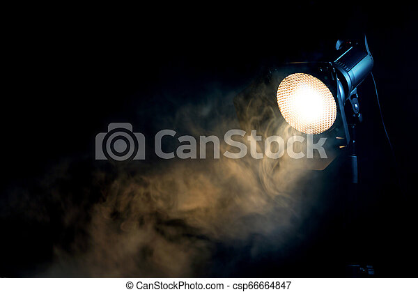 Yellow Light With Smoke Equipment For Photo Studio Yellow Light With Smoke On Dark Background Equipment For Photo Studio