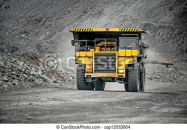 Yellow mining vehicle driving in the pit - csp12032604