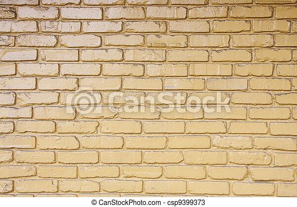 Yellow Painted Brick wall - csp9399373