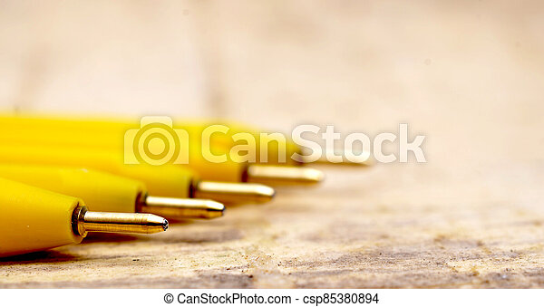 Yellow pen on wood background - csp85380894