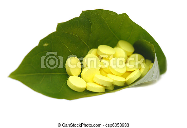 yellow pill in green leaf - csp6053933