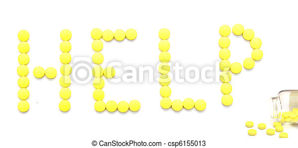 yellow pills spelling the word help over white background  - csp6155013