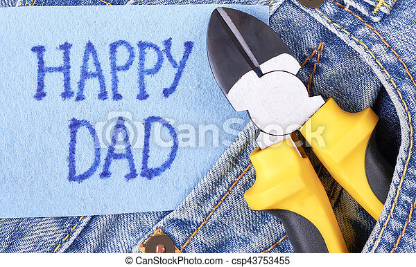 Yellow pliers on jeans pocket. - csp43753455