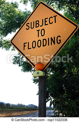 Yellow Road Sign: 'Subject to Flooding' - csp11022336