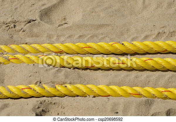 yellow ropes on resort beach sand - csp20698592