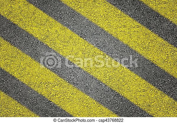 Yellow stripes on asphalt - csp43768822