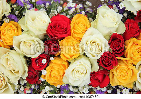Yellow, white and red roses in a wedding arrangement. Yellow, red ...