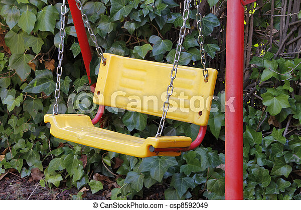 yellow with red legs swing in garden - csp8592049