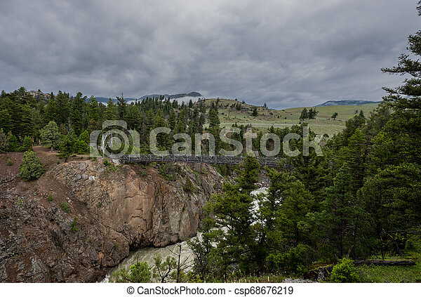 Yellowstone Wilderness and Suspension Bridge - csp68676219