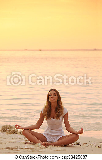yoga at sunset woman in lotus yoga pose at sunset on the