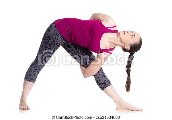 yoga baddha trikonasana sporty beautiful young woman