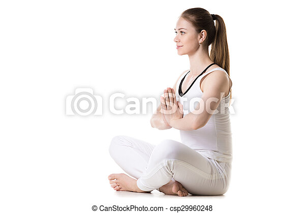 yoga easy pose portrait of young beautiful girl in white