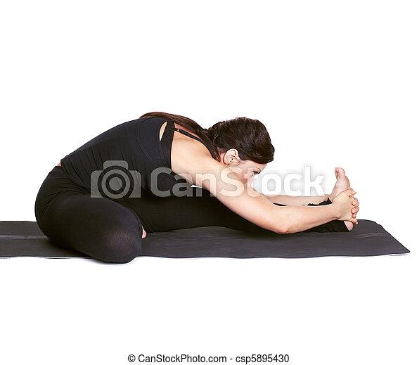 yoga excercising janu shirshasana fulllength portrait of