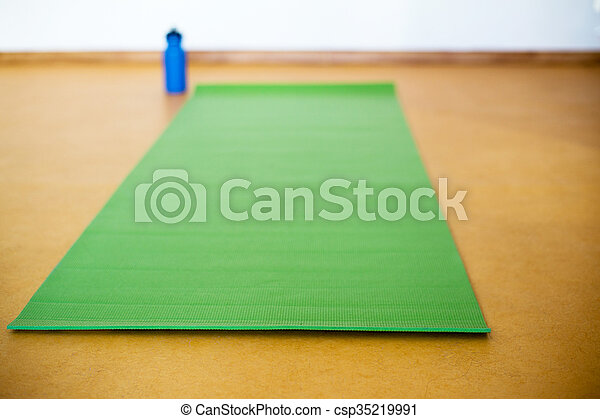 3a1cdcf333d73 Yoga mat, water bottle on yellow background. equipment for yoga. concept healthy  lifestyle. color.
