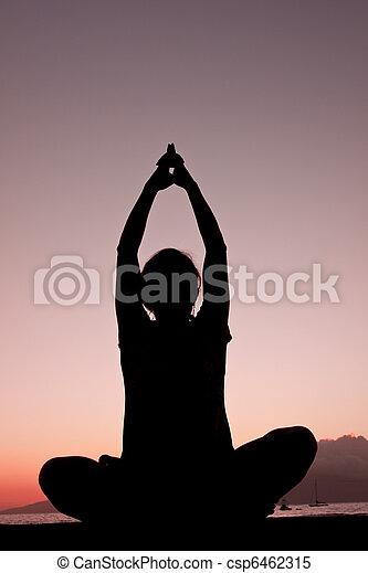 Yoga al atardecer - csp6462315