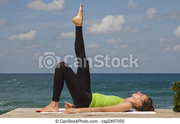 yoga outdoor relaxing exercises and yoga at the beach