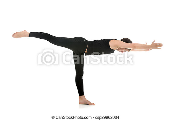 yoga pose warrior 3 sporty young man practicing yoga