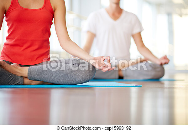 yoga practice lower part of slim female and man on