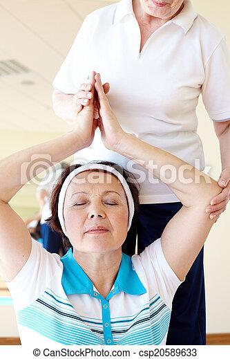 yoga practice portrait of aged female doing yoga exercise