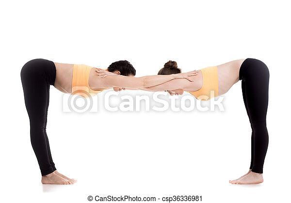yoga with partner ardha uttanasana pose two beautiful