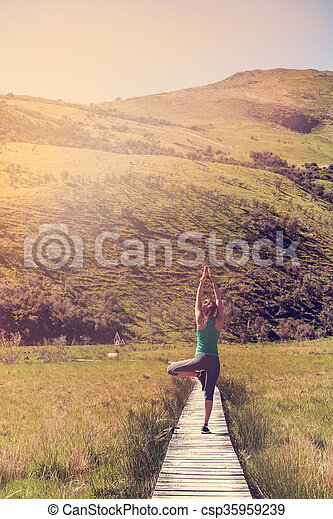 Yoga with young woman in the nature - csp35959239