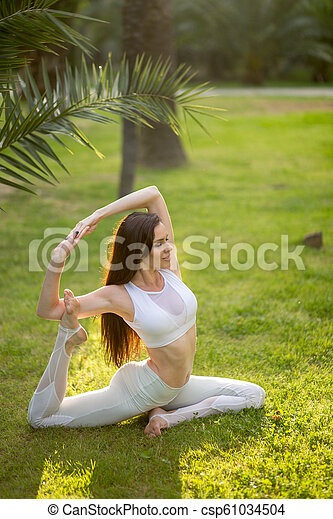 Yoga Woman Doing Morning Exercise In Summer In Park Healthy Lifestyle Yoga Woman In White Sportwear Doing Morning Exercise