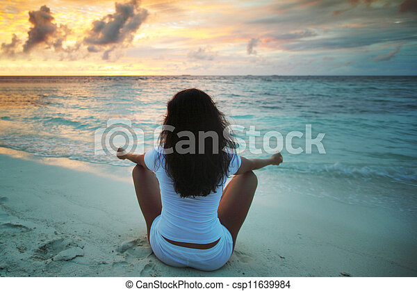 yoga woman on beach at sunset yoga woman in lotus pose on