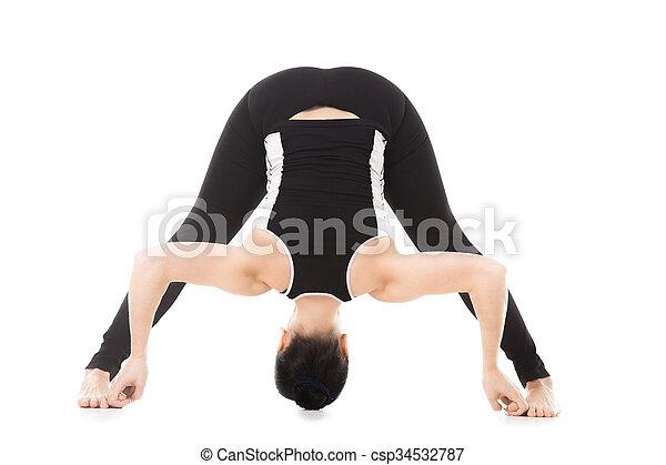 yogi female exercises yoga asana widelegged forward bend