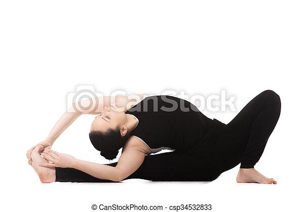 yogi female in yoga headtoknee forward bend pose sporty