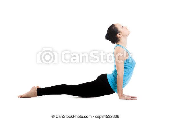 yogi female in yoga pose urdhva mukha shvanasana sporty