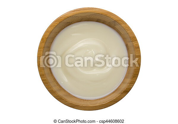 yogurt in wooden bowl isolated on white - csp44608602