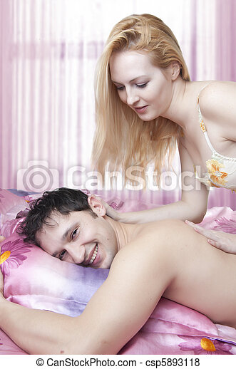Young adult beautiful lovers in bed. sex. - csp5893118